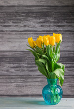 Yellow Tulips On A Dark Wooden Background