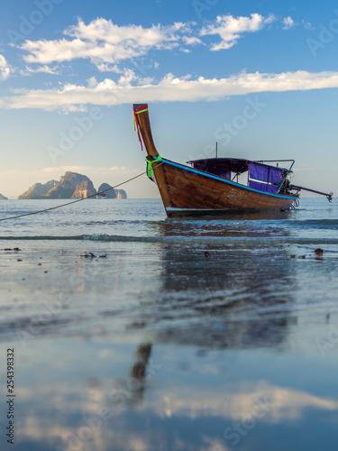 Wall Murals Photo of the day Traditionnal Long tail boat at sunset