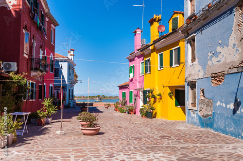 Poster Corail colorful burano island and and blue house with shabby plaster