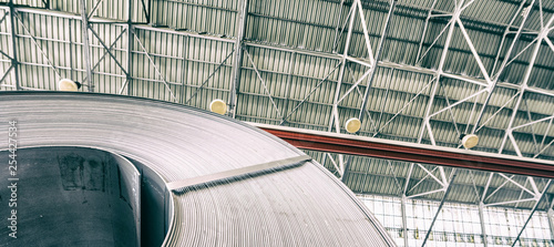 Industrial warehouse with rolls of steel sheet in a plant galvanized steel coil Canvas Print
