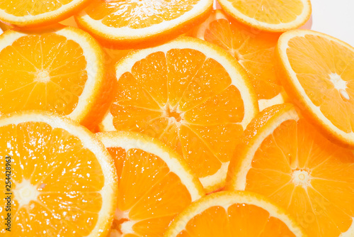Photo Stands Slices of fruit Orange sliced on a white background