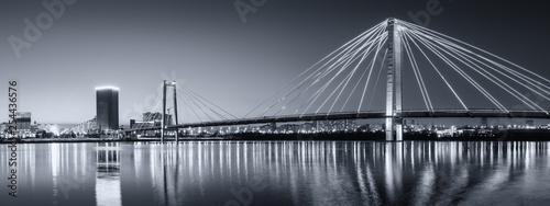 Fototapeta panorama night city of Krasnoyarsk bridge in lights obraz