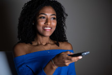 One Black Woman Watching Television At Night