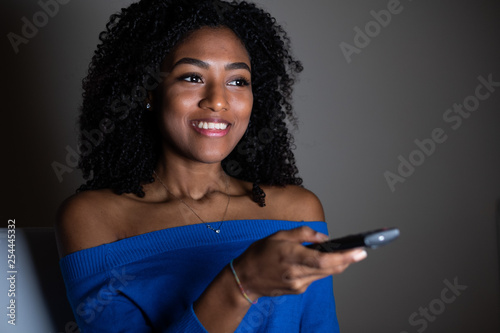 Fotografie, Obraz  One black woman watching television at night