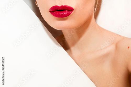 Fotografie, Obraz Glamorous fashion girl with red lips on white background.