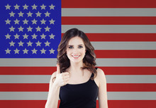 Portrait Of Happy American Girl With Thumb Up Against The USA Flag Background. Travel And Learn English Language Concept