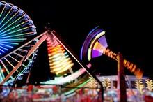 Neon Lights In The Adventure Park. Attraction Pendulum.