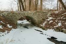 Bridge Over A Freezing Creek. ...