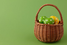 Wicker Basket With Painted Easter Eggs