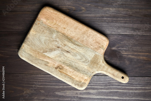 Cutting board on brown wooden table  Top view - Buy this