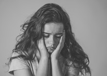 Close Up Portrait Of Teenager Female Suffering Depression. Sad Face, Unhappiness Human Emotion.