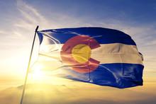 Colorado State Of United States Flag Waving On The Top Sunrise Mist Fog