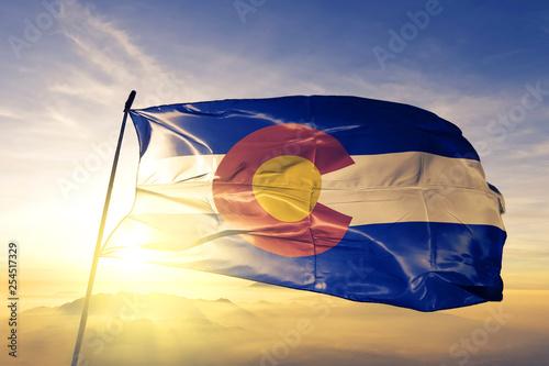Fotografía  Colorado state of United States flag waving on the top sunrise mist fog