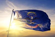 North Dakota State Of United States Flag Waving On The Top Sunrise Mist Fog
