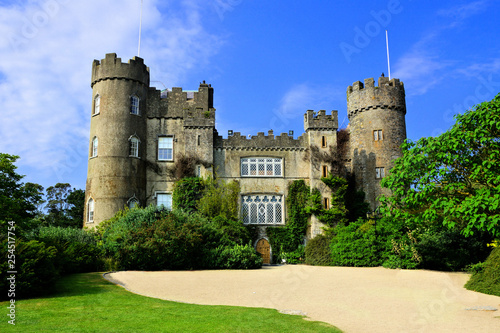 Photo View of the medieval Malahide Castle with green front garden, Dublin County, Ire