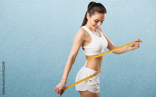 Fotografia  Weight lose woman loss waist abdomen belly