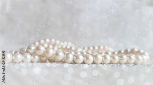 Nature white pearl beads on sparkling background Wallpaper Mural