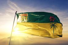 Saskatchewan Province Of Canada Flag Waving On The Top Sunrise Mist Fog