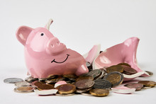 Broken Piggy Bank With Coins M...