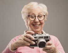 Senior Woman Using A Digital Camera