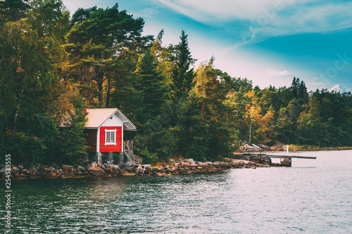 Red Small Finnish Wooden Sauna Log Cabin On Island In Autumn Season
