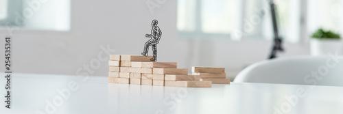 Fototapeta Hand drawn silhouette of a businessman climbing up the steps obraz