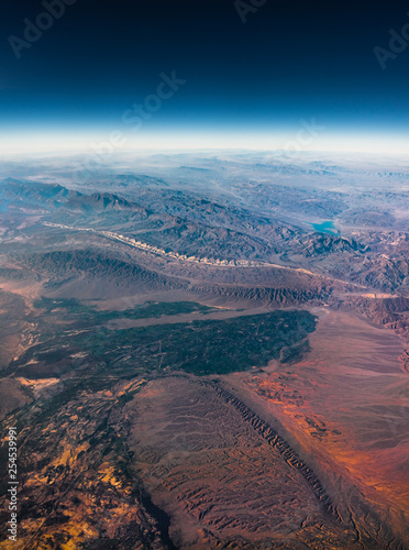 Photo Stands Candy pink Aerial View from an Airplane. Flying above Beautiful Land at Sunrise.