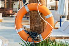 Safety. Orange Lifebuoy Hangin...