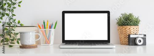 Fototapeta  Laptop on creative desk full of school accessories. Learning workspace. obraz