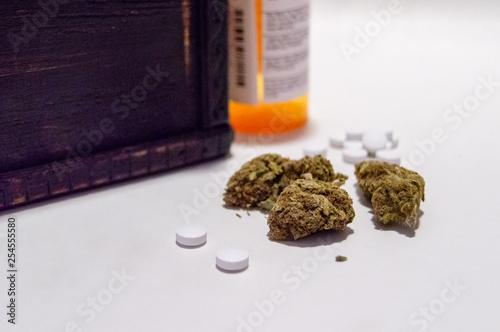 Fotografie, Obraz  Cannabis marijuana and prescription pain pills narcotics