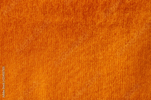 Orange knitted fabric texture as background, closeup Fototapet