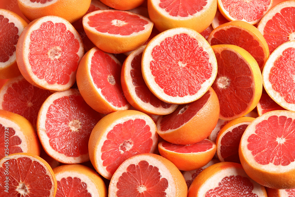 Fotografie, Obraz Many sliced fresh grapefruits as background, top view