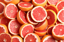 Many Sliced Fresh Grapefruits ...