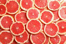 Many Sliced Fresh Grapefruits ...