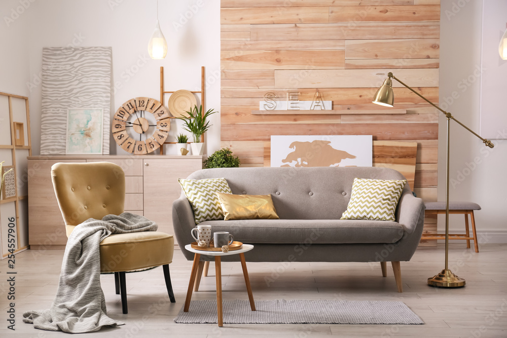 Fototapety, obrazy: Stylish living room interior with comfortable sofa. Idea for home decor