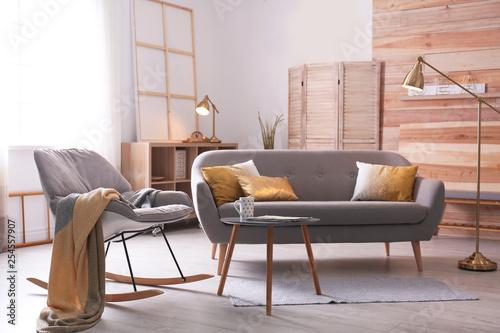 Foto  Stylish living room interior with comfortable sofa