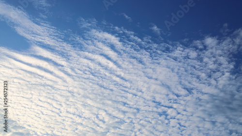sunlight shiny through white cloud on blue sky background Wallpaper Mural