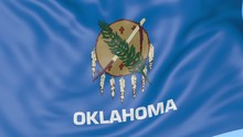 Waving Flag Of Oklahoma State Against Blue Sky. Seamless Loop 4K Clip
