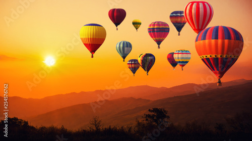 Poster Montgolfière / Dirigeable Blur of image hot air balloon above high mountain at sunset