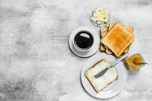 Toasted Bread With Butter And Hot Coffee.
