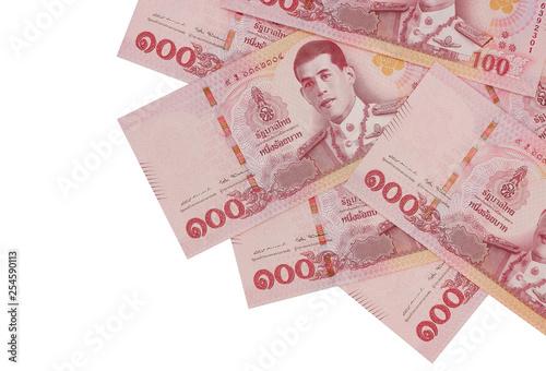 Fototapeta Pile of new one hundred Thai Baht banknotes, isolated on white background