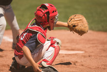Youth Baseball Catcher During Game