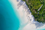 Amazing island with sand beach green tree forest aerial view