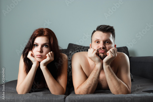 A couple, a man and a woman are lying in bed without sexual desire, apathy, love is over Canvas Print