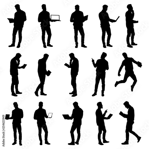 Obraz Set of working business man using laptop and tablet silhouettes. Easy editable layered vector illustration. - fototapety do salonu