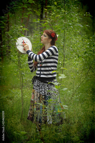 Fotomural gypsy with a tambourine in the forest