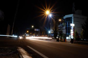 Fototapeta na wymiar Artistic style dark defocused and blured lights of night in the city