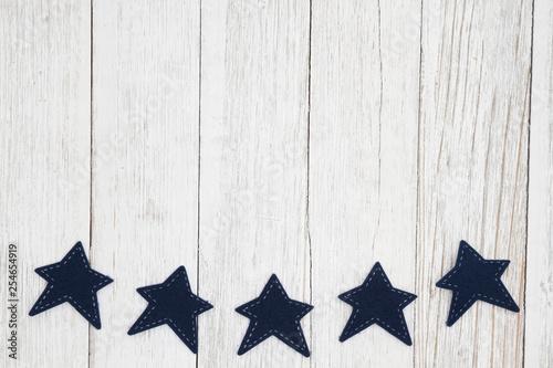 Blue stars on weathered whitewash textured wood background