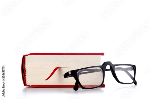 Fotografiet  red book and  eye glasses isolated on white background with copy space for your