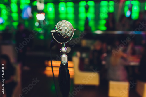 Microphone. Retro microphone. A microphone on stage. A pub. Bar. Restaurant. Classic. Evening. Night show. European restaurant. European bar. American restaurant. American bar. - 254655989